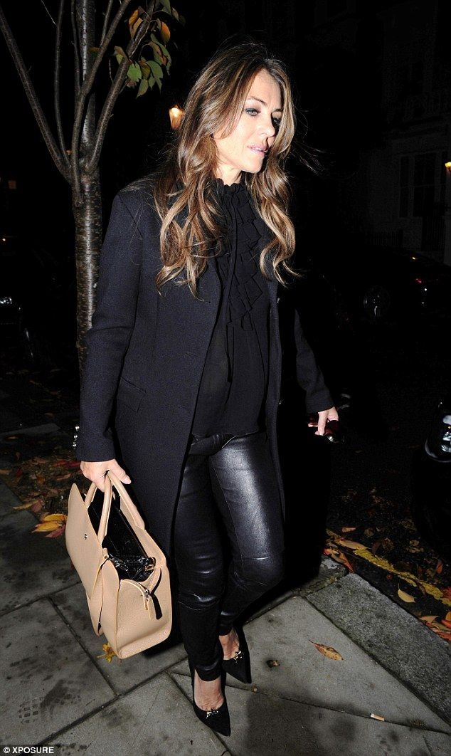 Fashion-forward: The brunette beauty looked sensational in skin-tight leather trousers, wh...