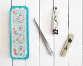 Floral beauty travel kit. Turquoise blue tin box, manicure set with beauty products. Roses. Vintage, shabby chic. Cath Kidston style