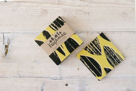 Golenrod and black streaked Drops add colour and pattern to your dining or coffee table. These birchwood coasters are handmade and finished to be water resistant and food safe. Buy these and matching serving trays and table linens at keephousestudio on Etsy.