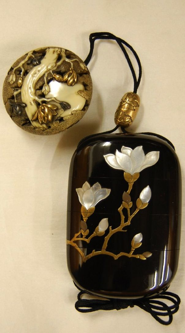 Magnolia blossoms. Japanese netsuke (manju) made of carved ivory; also silver, gold.