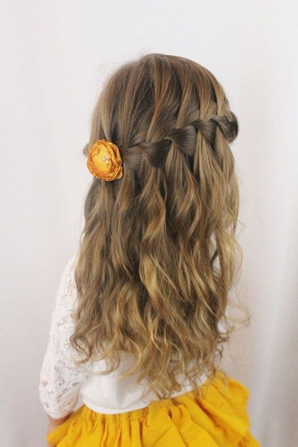 Flower girl with waterfall braid and little yellow flower @myweddingdotcom