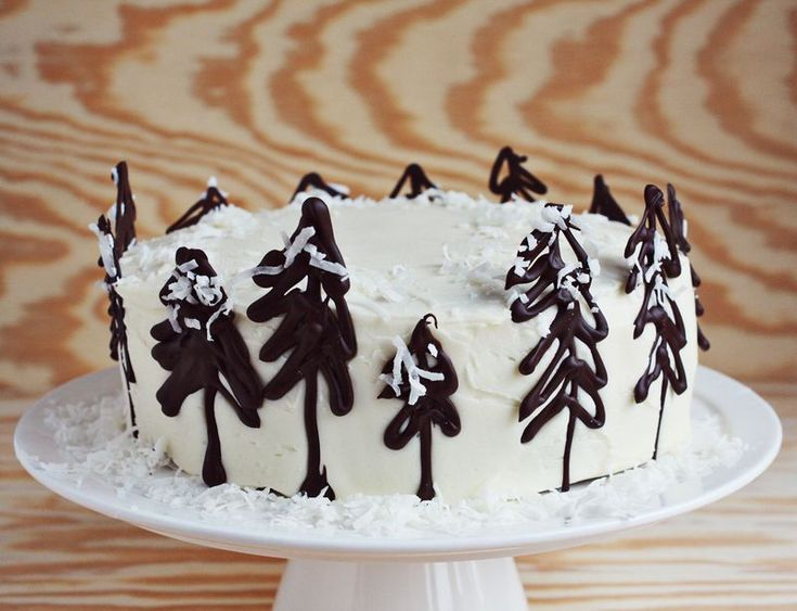 chocolate trees for cake decorating // a beautiful mess ... melt dark chocolate chips, pour into ziplock bag, cut small hole in corner, draw rustic trees onto wax paper, sprinkle with coconut, set over night or in fridge, carefully remove.