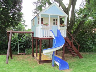 Cute- painted like a real house.  And awesome slide
