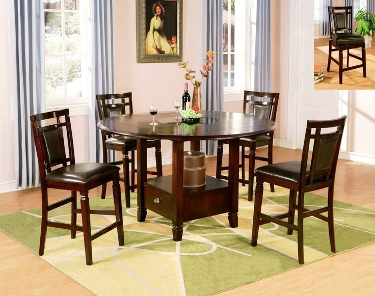Keep it casual with this super cute pub set! #cheers  | Counter Height Dining Set (Round) | Unclaimed Freight Co. | Lancaster, PA | With its round shape, this counter height dining set is a perfect gathering spot for your kitchen, dining room or home bar area. This Dark Merlot Pub Dining Set is crafted from Asian hardwoods with a drop leaf, granite lazy Susan, and a storage base.