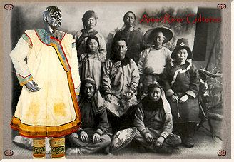 Amur River Peoples. mannequin in traditional salmonskin coat with photo of a Nanai family