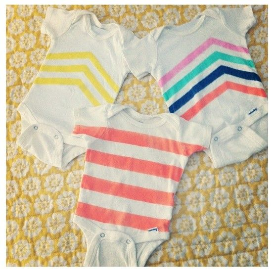 Easy... onsies, painters tape, martha stewart craft paint, stencil sponge... have fun!  Great baby shower craft.