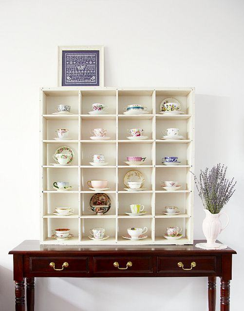 Teacups.  I have a teacup collection as well, and I'd like this display case to showcase them all.