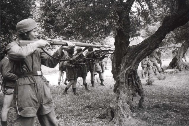 Crete, Greece. German paratroopers executing local partisans that were murdering their comrades. May-June 1941.