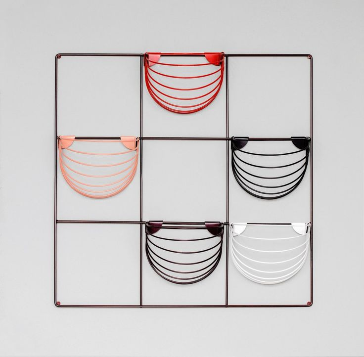 Wallment Baskette powder painted metal wall baskets in black, white, nude, red and black red. Finnish Design.