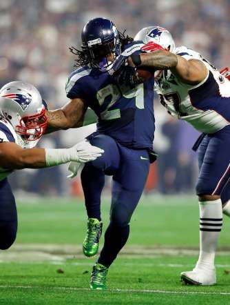 Seattle Seahawks running back Marshawn Lynch (24) runs the ball against New England Patriots defensive tackle Sealver Siliga (96) during the second quarter in Super Bowl XLIX on Feb. 1.