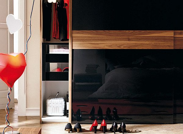 Modern Sliding Doors Wardrobes: Adding Style to Your Bedroom: black reflective sliding doors with wood accent