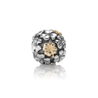 Pandora lucky clover in gold and silver