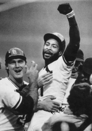 October 14, 1985 -- St. Louis Cardinal Ozzie Smith reacts to the crowd and his teammates after hitting a game-winning home run in the ninth inning to defeat the Los Angeles Dodgers 3-2. Tommy Herr pats his chest.  AP file photo