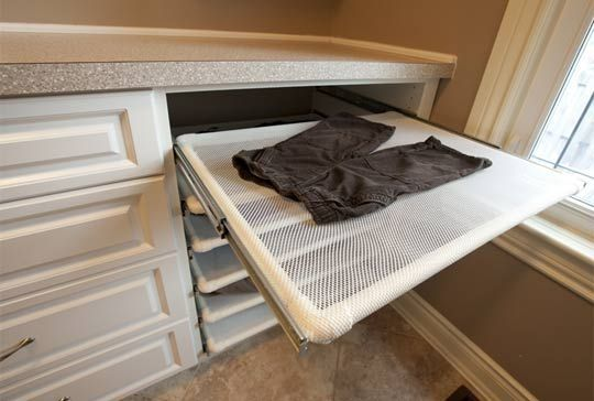 "Built in air dry clothes rack (via Re-Nest) - perfect for ""lay flat to dry"" sweaters."