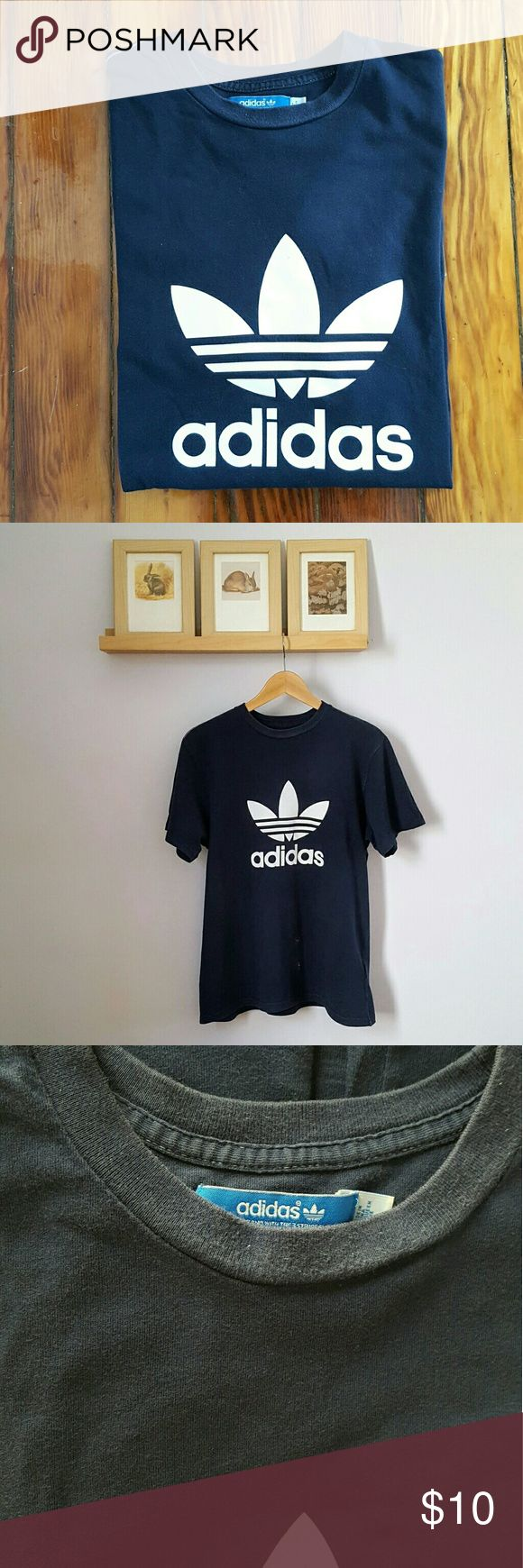 """Navy Blue Adidas T-Shirt Navy Blue Adidas T-Shirt. By Adidas, made in China. 100% cotton. Marked a size M- 20.5"""" armpit to armpit, 27"""" long. Please note that this is in somewhat distressed condition with fading, some very light pilling and a couple paint stains on the front (last three pictures). This would be a great shirt to crop, distress more or wear as is! #adidas #unisex adidas Shirts Tees - Short Sleeve"""