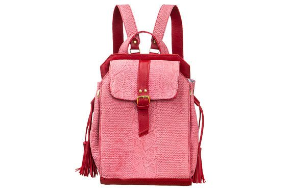 The elegant bag is made by hand. Backpack is made in pink with touches of red, this design will give your image a greater tenderness and femininity! Backpack is decorated with embossed imitation...