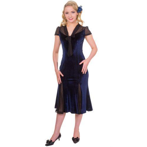 Echte vintage jurk met typische fluweel stof in nacht blauwe kleur. Met verborgen rits aan de achterkant. 100% Polyester.