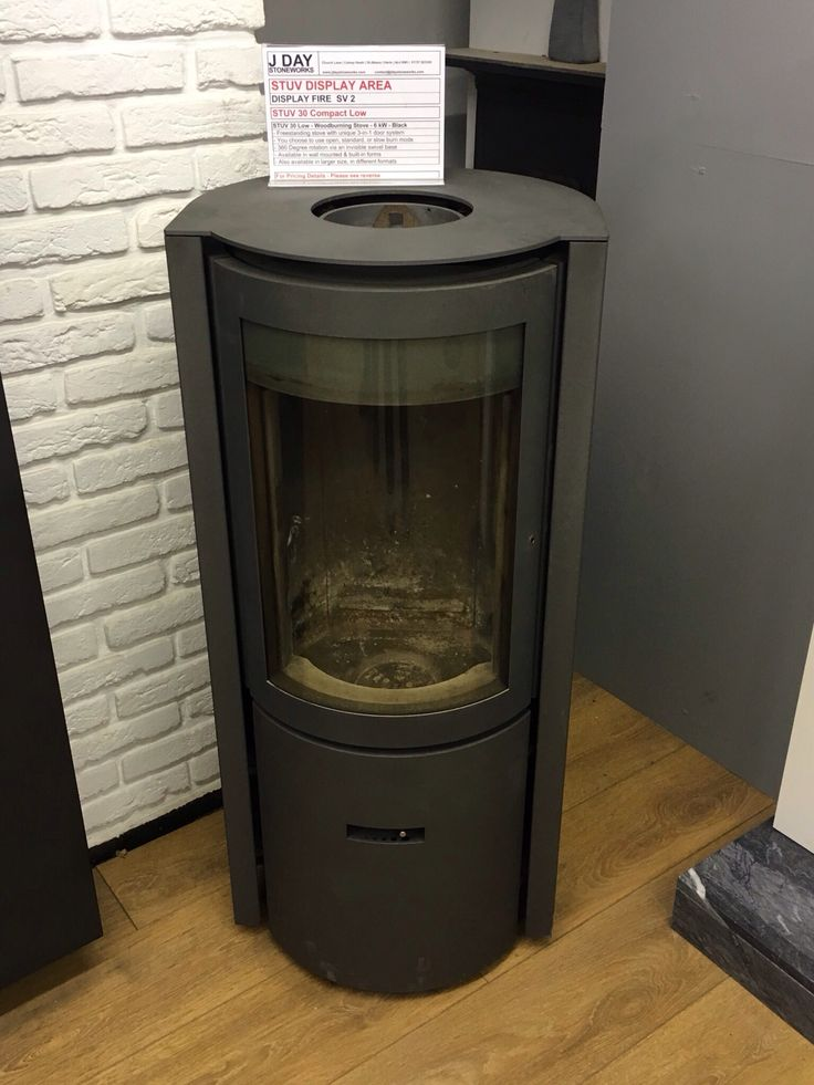 The Stuv 30 Compact Low woodburning stove with 360 degree rotation