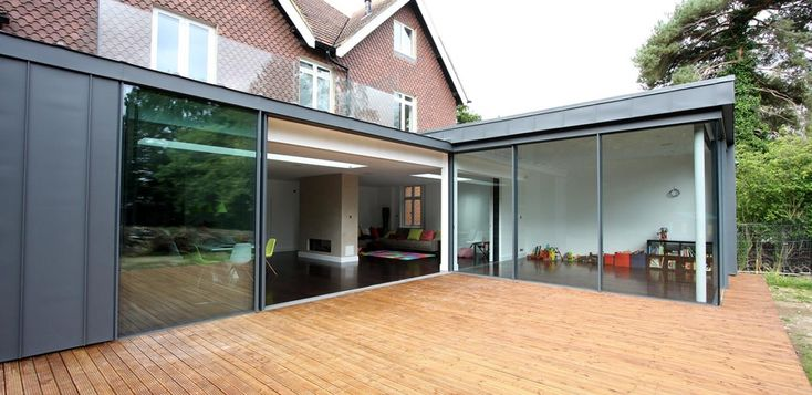 Designed by an award winning architects practice this contemporary extension was made to improve the layout and living space. The glass extension replaced an outdated two storey extension