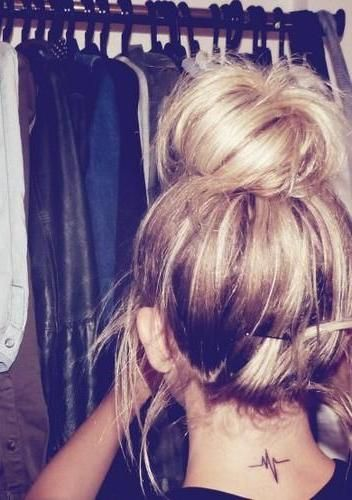 The messy bun is cute and all, but I LOVE her tattoo!