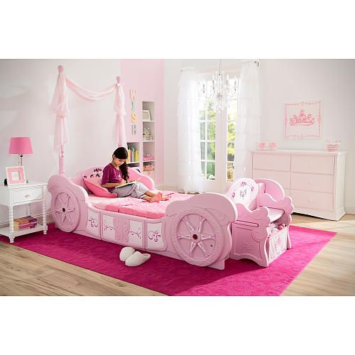From pretty princesses to royal castles, the Disney Princess Carriage Toddler-to-Twin Bed from Delta Children evokes the characters and stories girls love to dream about. Ready to transform any room into an enchanted space for adventures real and imagined, the bed is designed with all the regal trimmings.