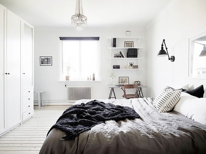 PHOTO: Jonas Berg for Stadshem We love the layout of this bedroom that positions a handy IKEA trestle table in the corner for easy access and late-night note scrawling.