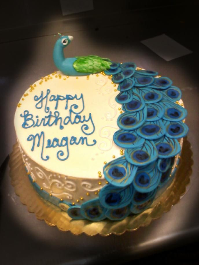 This buttercream iced cake has custom-made fondant peacock, with hand-painted fondant peacock feathers cascading down the one side of the cake.  This cake has edible gold beads and a fondant sash around bottom of the cake.