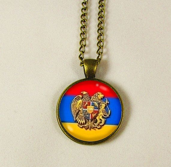 Measuring 1 (2.5cm) in diameter with a glass dome cover the image inside is of the Armenian flag with the crest of Armenia in the front.  The pendant setting is made of antique bronze alloy, whereas the curb chain is made of alloy as well.  This necklace has a lobster clasp and extender on the ends and measures 20 (51cm) in length.  For more of our Armenian items please visit this section in our shop:  https://www.etsy.com/shop/DoniainArt?section_id=16577278&ref=shopsection_leftnav_1   If…