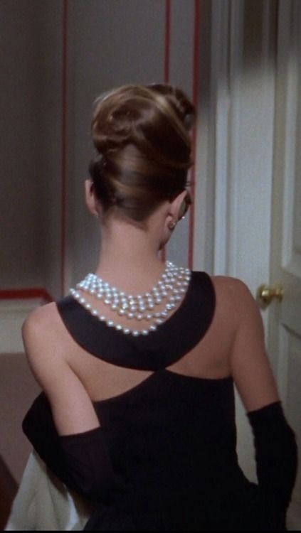 Audrey Hepburn in the iconic Breakfast at Tiffany's scene - love her hair & the necklace and never realized how great Audrey looks from the back as well as the front! ;)