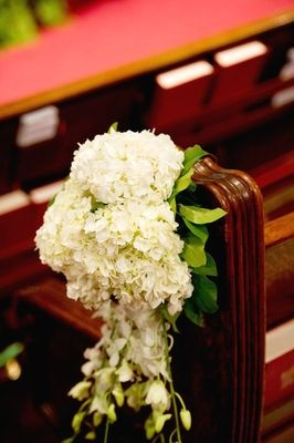 Loved the pew flowers!