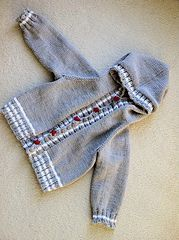 This is a top down raglan hoodie for a baby or toddler. It starts at the top of the hood with a turkish cast on. Knit back and forth the hood edge and button band are picked up after the desired length is attained. The sleeves are placed on holders and knit down to the cuff.