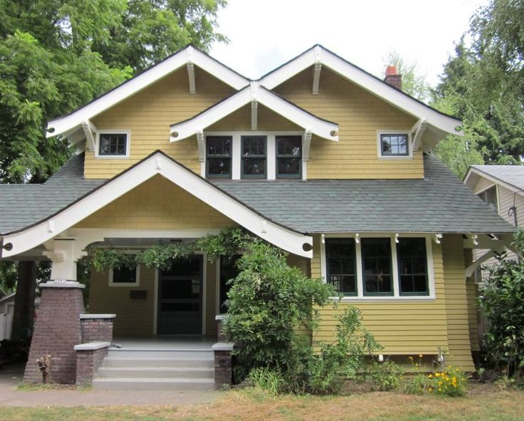 Portland, Oregon 1912 Craftsman Exterior After Restoration. The Roof  Extends Over The Driveway  A Porte Cochiere.