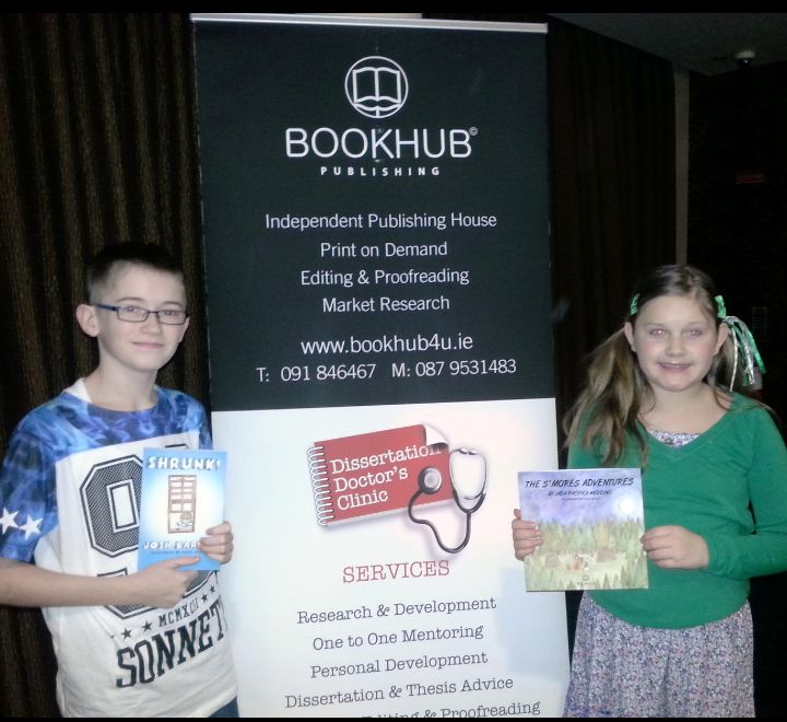 Young Book Hub Publishing authors, Josh Earley and Jada Wedding proudly standing with their books on the day of our joint book launch.
