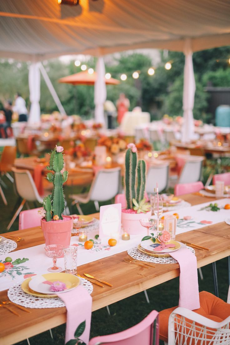This is the pretty pink party of our dreams. Add in cactus centerpieces (with flowering buds!) and we're in heaven. But note: The sleek tables, white linen runners, and metallic flatware are essential additions—this is your wedding, not your birthday party.