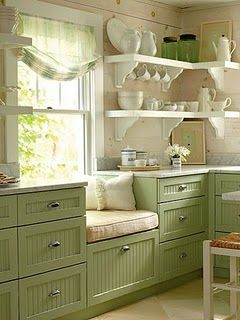 When replace windows, make the dinette window longer and run the bench from corner (screen door cabinet) under the new window and towards the stairs.  Storage under the bench should be drawers, some will have vertical slots for holiday platters, etc.
