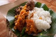 "Gudeg is a sweet young jackfruit dish usually served with nasi (rice), tahur egg, ayam (chicken), sambal and krecek (crunchy beef skin).  ""Traditional food from Yogyakarta"""