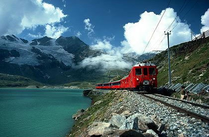 The Bernina Express is an express train connecting Chur (or Davos) in Switzerland with Poschiavo and Tirano in Italy, by crossing the Swiss Alps from north to south. For most of its journey, the train also passes along and through the World Heritage Site known as the Rhaetian Railway in the Albula / Bernina Landscape