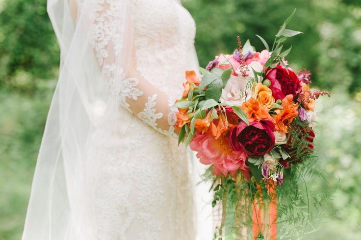 Stunning Red, Coral, Wine bouquet for one of our fashion-forward brides