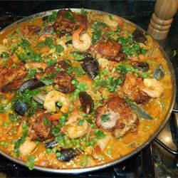 Easy Paella Allrecipes.com This is so tried and so true. I make it and savor the safron, the seafood, the chorizo (if I can find it) and all the other flavors of Spain. It's not 100% authentic (e.g. crushed chili peppers) but it's close. Serve with a side of crusty bread and some light, creamy nata or rice pudding for dessert.