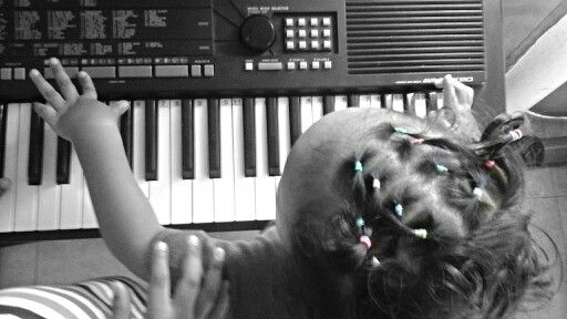 Fotografia Niña tocando Piano