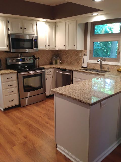 countertop sneakersteal Cabinets For shoes cabinets   White Counters  and granite Granite    run free  Granite Kitchen Home the