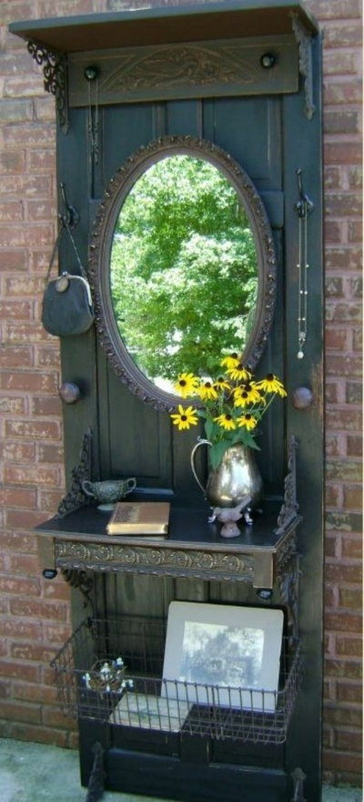 salvaged wood door.  Could do something similar but use hooks to use as entry way table/rack