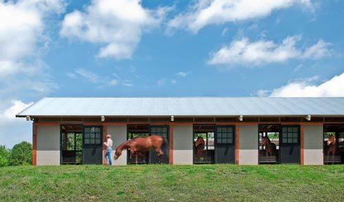 This Shedrow Style Barn Uses Light Colored Reflective