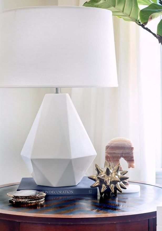 Eyecatching accessories—like this geometric lamp and eclectic coaster set— are really what make a house a home. Click here for more home décor inspiration.