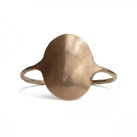 Open cuff with oval shield (3,5x4,5). Made in italy with bronze. Nickel Free.