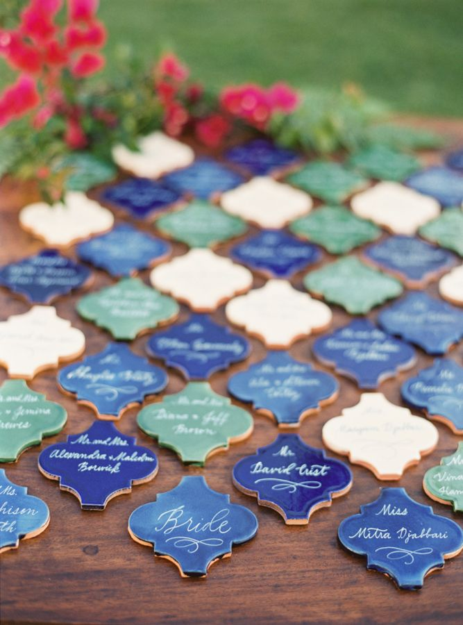 Terracotta tile escort cards: http://www.stylemepretty.com/2015/08/31/shades-of-blue-santa-barbara-wedding/ | Photography: Jessica Burke - http://www.jessicaburke.com/
