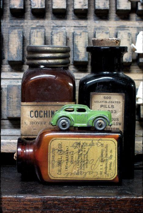 vintage bottles. vintage mini car