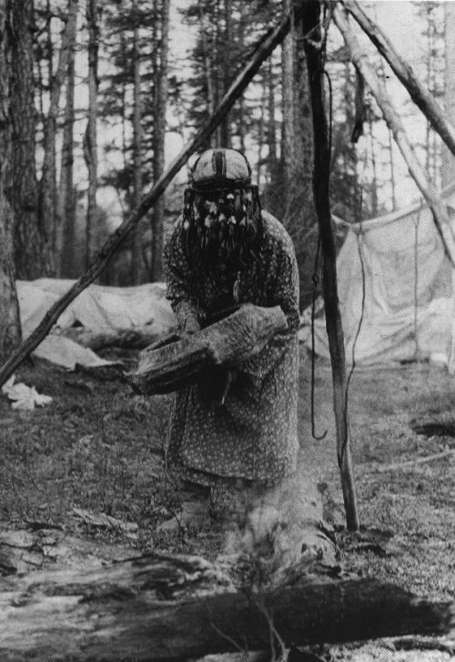 Evenk shamaness heating her drum over fire. Photo by A. Slapins, 1975  Heating the drum before use was necessary because the heat tightened the drum skin and changed its pitch. Basically, the shaman used the fire for tuning his/her drum.