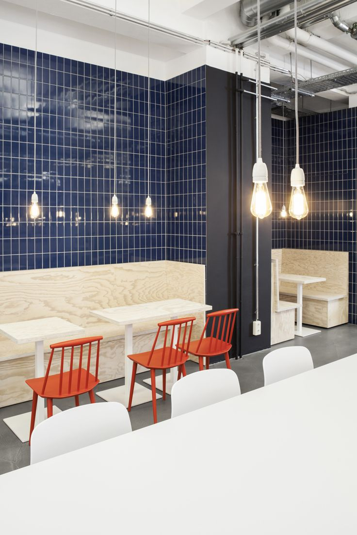 zalando - berlin - industrial - industriel - canteen - kantine - factory restaurant - staff restaurant - cafeteria - design - clean - wood - framework - withe - bench - bank - chairs - stühle - orange - tiles - fliesen - blue - blau - seating niches - seating areas - sitznischen