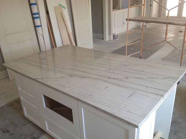 Backsplash Ideas For White Macaubus Quartzite In An Off White Kitchen